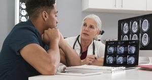 doctor talking to athlete about concussion