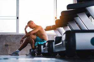 Athlete sitting on treadmill
