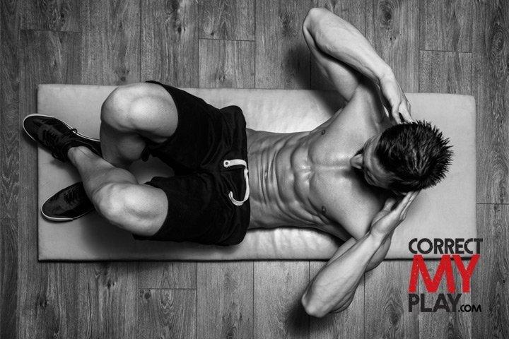Man doing situps on a mat